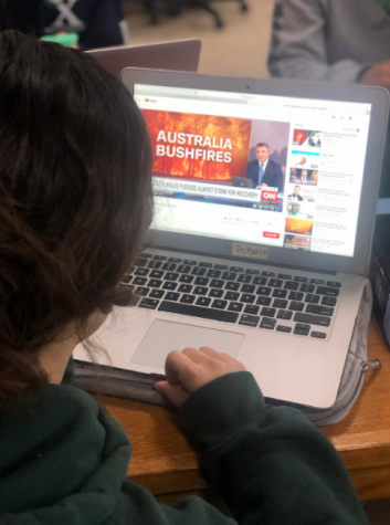 Sienna Martinez '21, watching News about the Australia Bushfires taken by Janessa Gutierrez '21