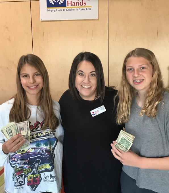 Julia Bonilla and Elizabeth Church donate their earnings to Helping Hands.