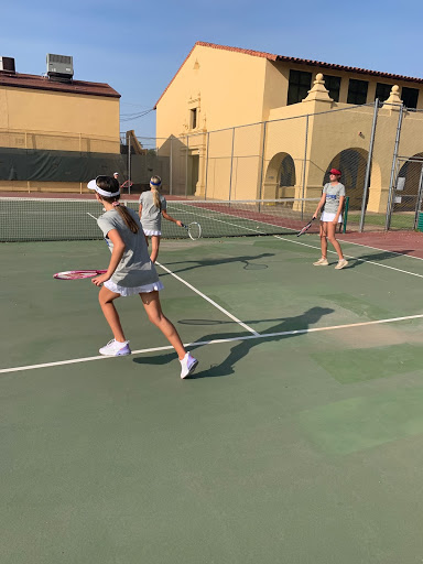 Baby gator Ashley Mansour gets ready to return the ball during after school frosh tennis practice!