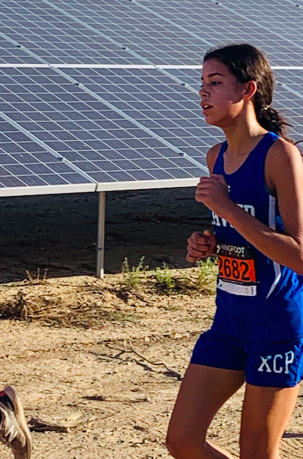 Naomi Young '23 maintains her speedy pace during the final mile of the sandy 5k course at the Eye of the Tiger meet on October 24, ultimately finishing 16th overall in the Varsity Gold race.