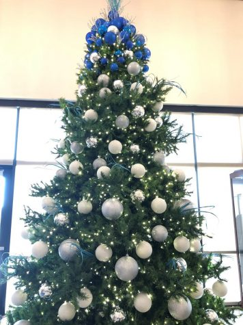 From November to the end of the Christmas season, Xavier's amazing staff puts up many decorations, such as this tree in the Activity Center, to celebrate Jesus's birth and the Christmas season. Xavier's Key Club raised money to pay for these trees and then donated them to Xavier families in need every year.