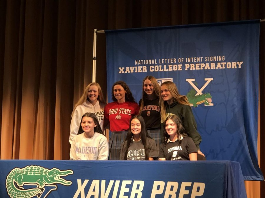 On November 18, 2020, seven students, Macy Lee, Mia Rankin, Serena Turner, Elizabeth Woudenberg, Anahi Cardinal, Mary Beth Doss, and Lauren Garcia, pose after signing national letters of intent at a signing event in the Performing Arts Center.