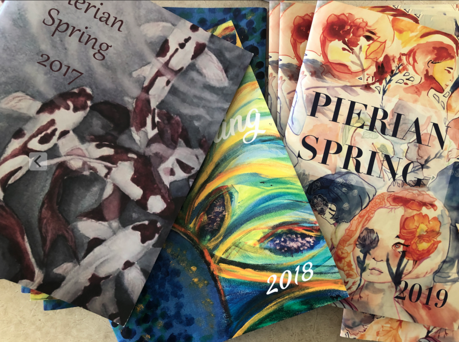 Pierian Spring issues from past years display student art on front covers. Club members created and selected each piece of art and designed the front cover and inside of each issue.