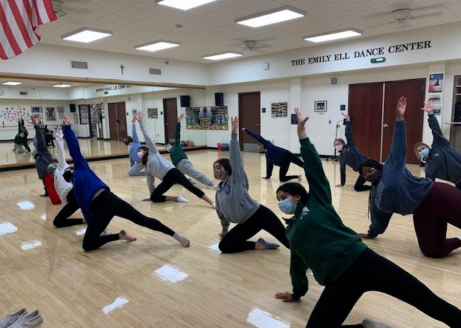 Xavier+students+in+Intermediate+Dance+stretch+before+they+dance.+Students+worked+together+to+learn+a+dance+that+they+will+perform+at+the+end+of+the+year.
