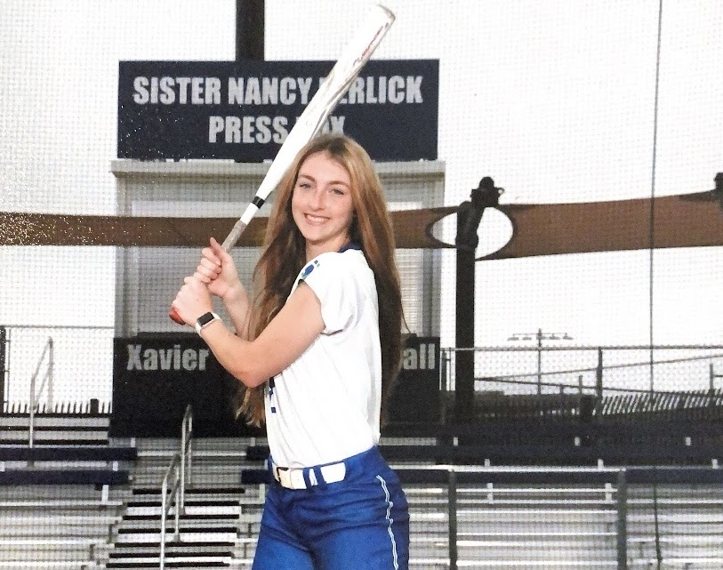 Bridget+Donahey%2C+who+was+recently+ranked+the+17th+best+softball+player+in+the+class+of+2022+in+the+nation%2C+poses+for+her+softball+picture+on+Petznick+Field+at+Xavier+College+Prep.