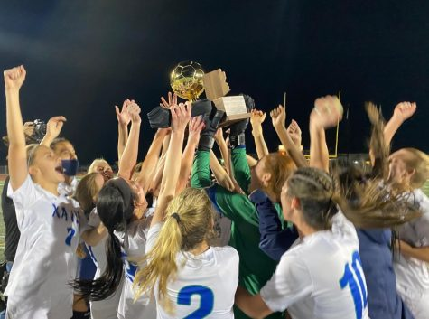 On Friday March 19, at Campo Verde High School, the Xavier varsity soccer team celebrates their state championship win.