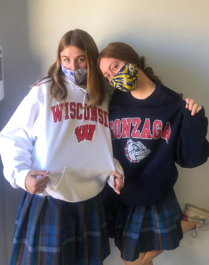 Seniors Reese Dietrich and Kassidy Espinosa pose in their college gear on College Sweatshirt Day.