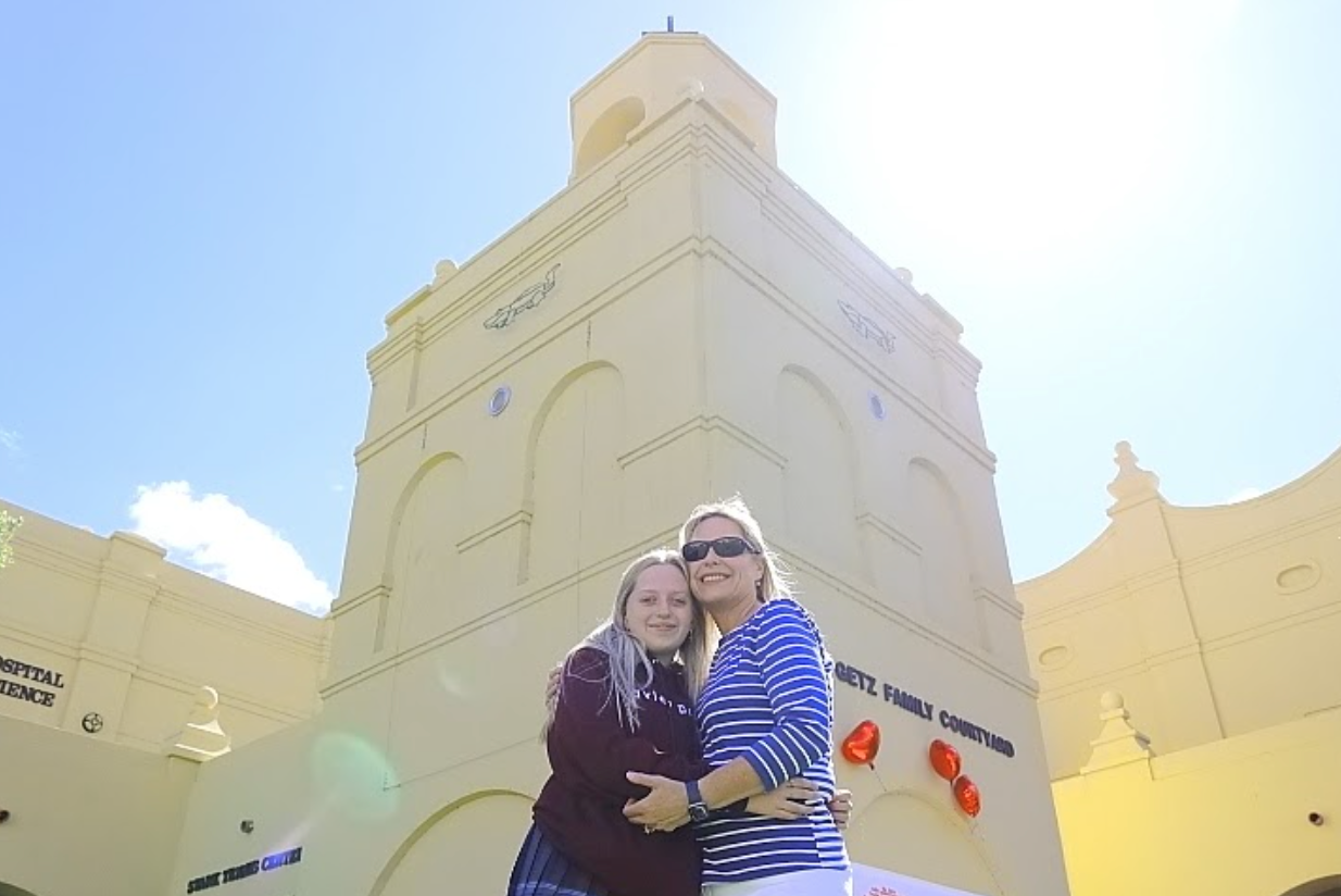 Elayna Pennell and her mother Tiffany Albers '89 pose by the Bell Tower. During their interview at Xavier, Albers reminisced as she compared the physical structure of Xavier from when she attended to now.