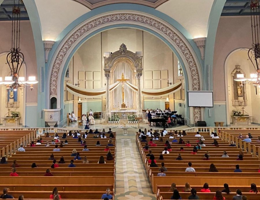 The class of 2021 attends the moving- up Mass, celebrating the baptism, and confirmation of three seniors.
