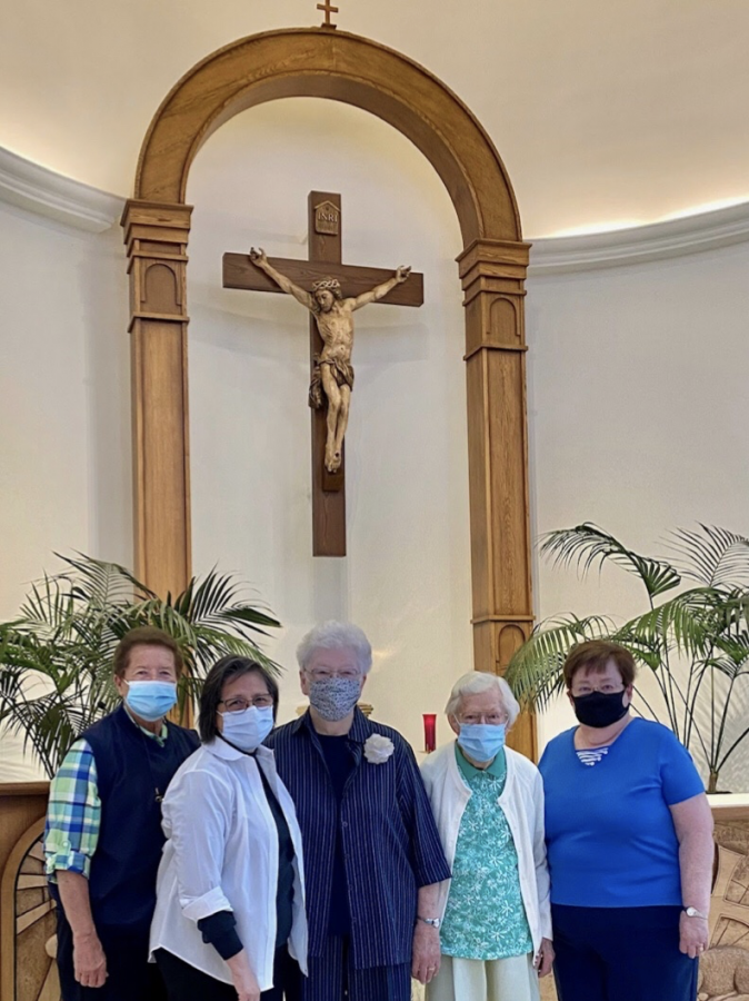 (Left to right) Sister Lynn Winsor, Sister Isabel Conchos, Sister Joan Fitzgerald, Sister Lillian Lila and Sister Joanie Nuckols attending a 7 a.m. Mass in the Chapel of Our Lady.