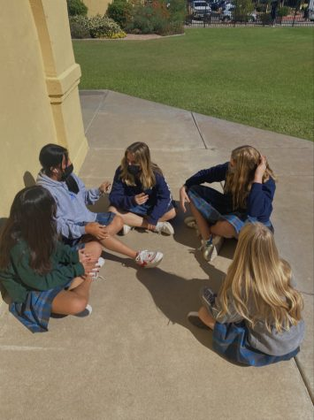 Xavier sophomores utilize their break outside to enjoy each other's company. They listen to music, talk with each other and reset their minds for their next classes.