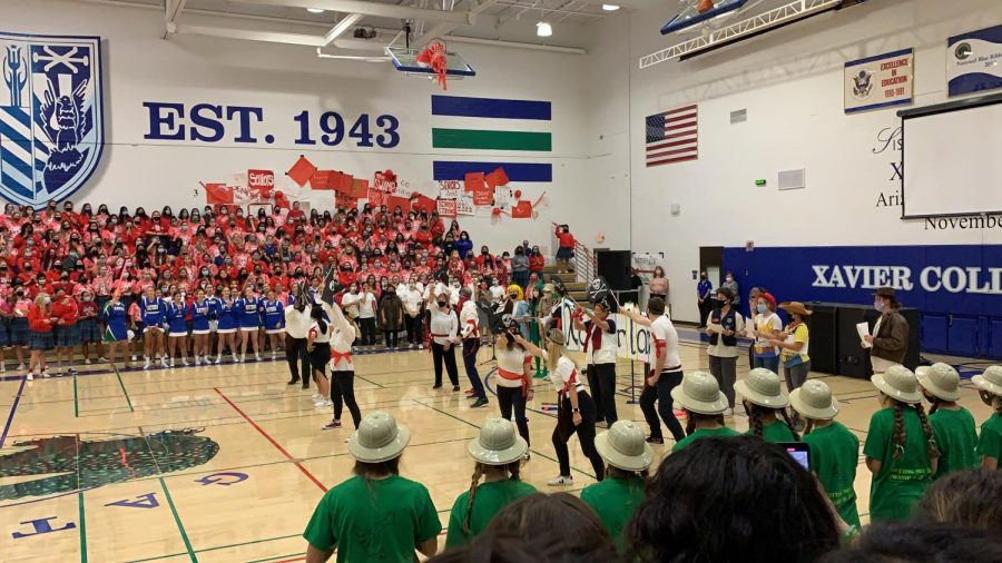 """The Xavier faculty triumphantly dominates the court with their """"Pirates of the Caribbean"""" themed dance. In participating, the faculty not only joined the fun, but allowed the students to get to know them through their enthusiasm and school spirit."""