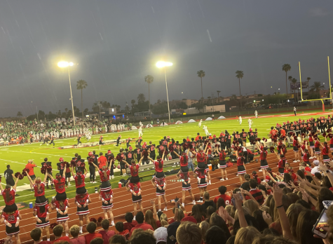 During the first moments of the game, students get ready for the initial kickoff. This kickoff started the first victorious football game of the season against St. Mary's Catholic High School.