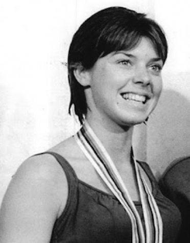 Jeanne Collier, who graduated from Xavier College Prep in 1964, poses with her silver medal for diving after the Tokyo Olympics medal ceremony in 1964.