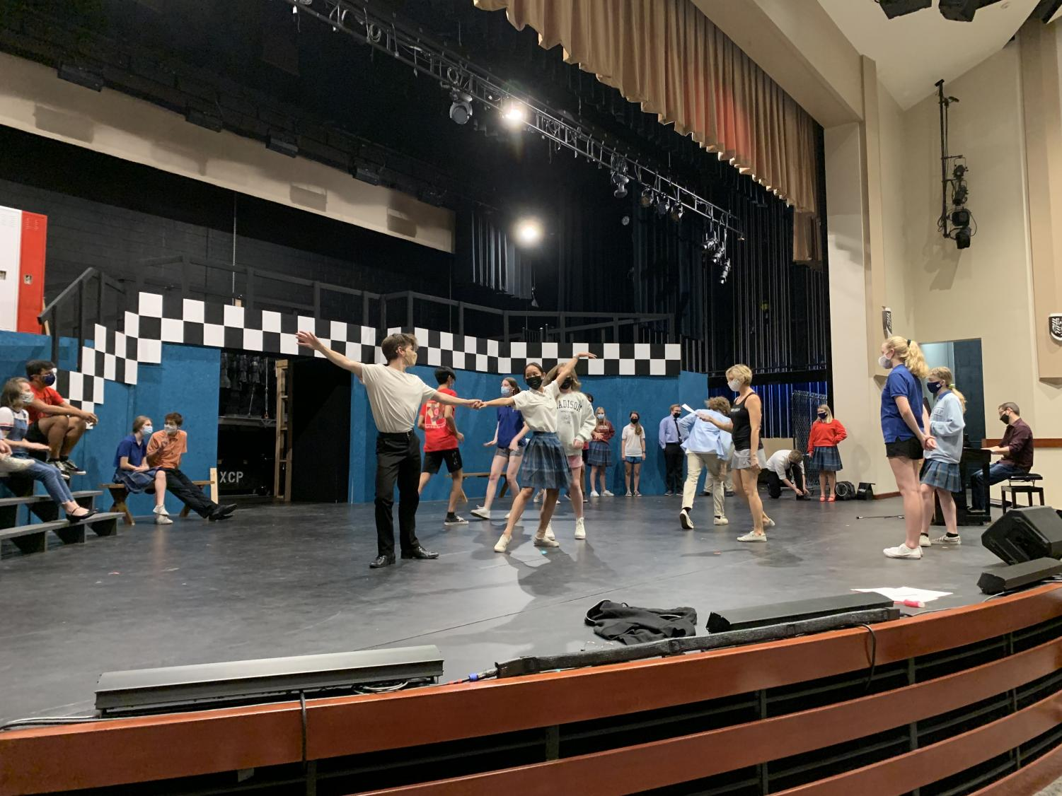 Xavier and Brophy actors take the stage as they rehearse for the dance number in the upcoming scene. A commitment to long rehearsal hours from the cast and crew is essential for a successful opening night.